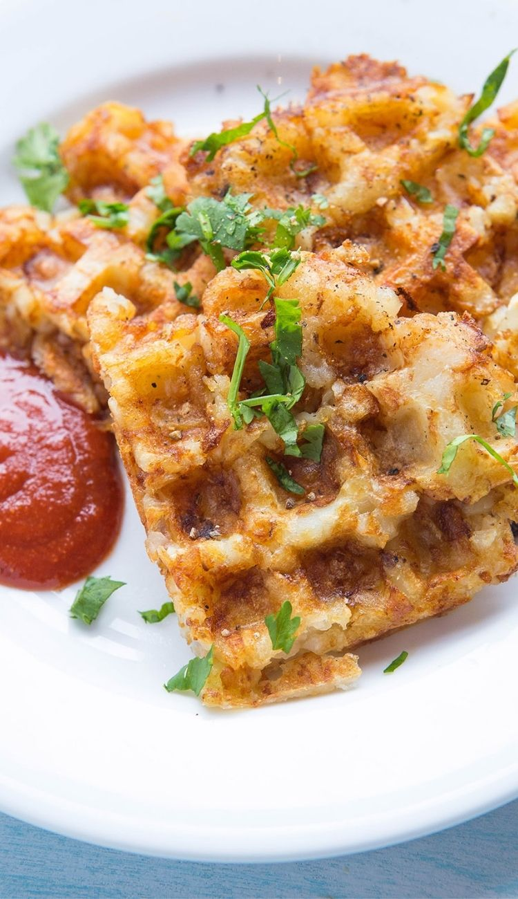 tator tot hashbrown waffles with a side of ketchup