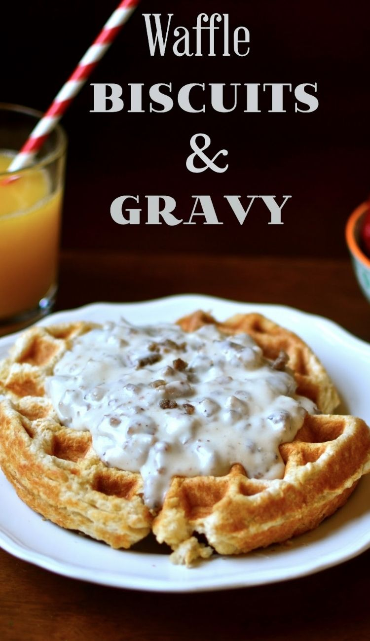 waffle biscuit and gravy with a glass of orange juice