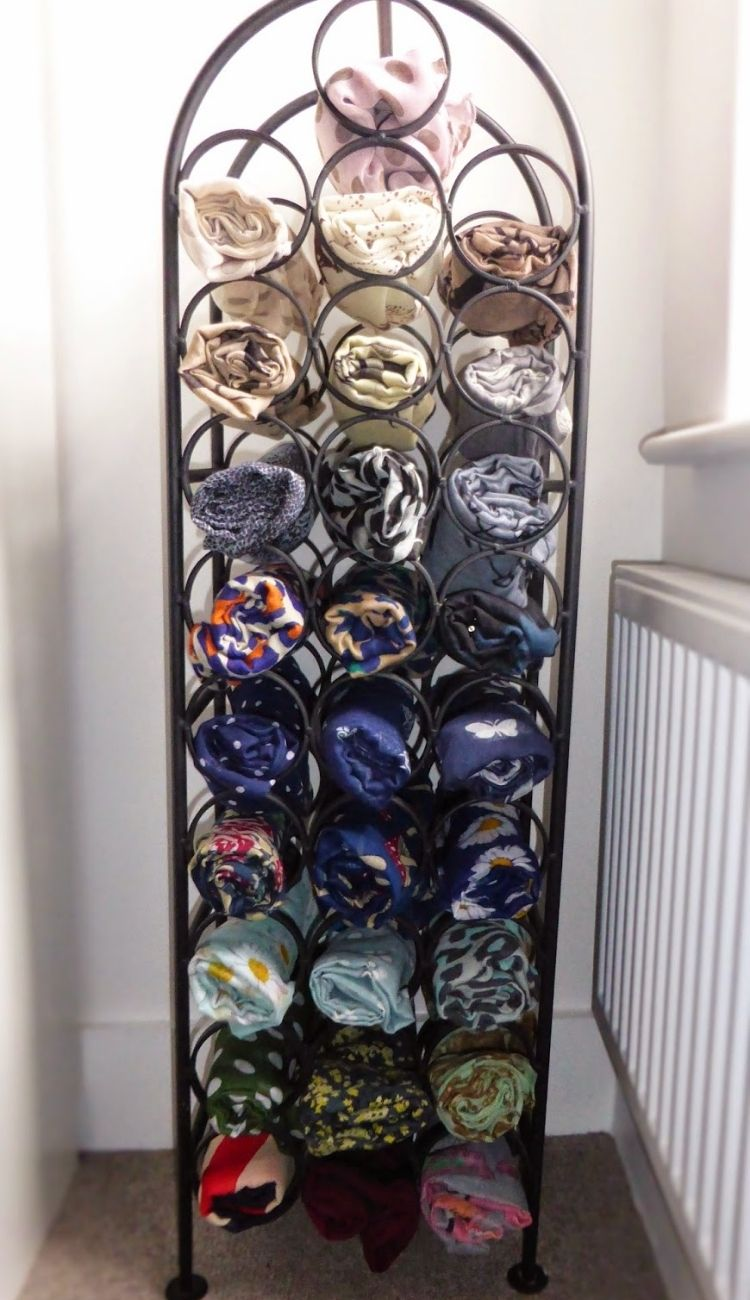 scarves rolled up and stored in a wine rack