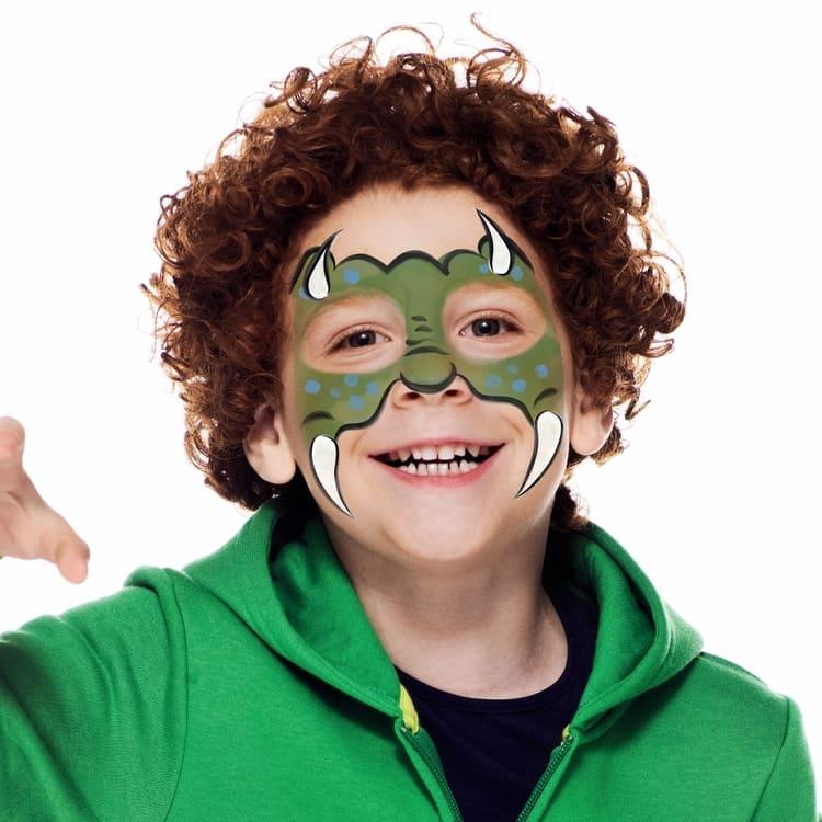 boy with dinosaur face paint