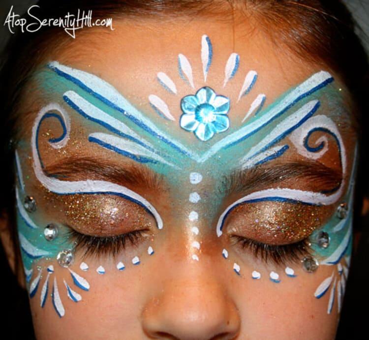 Girl with fairy princess face paint