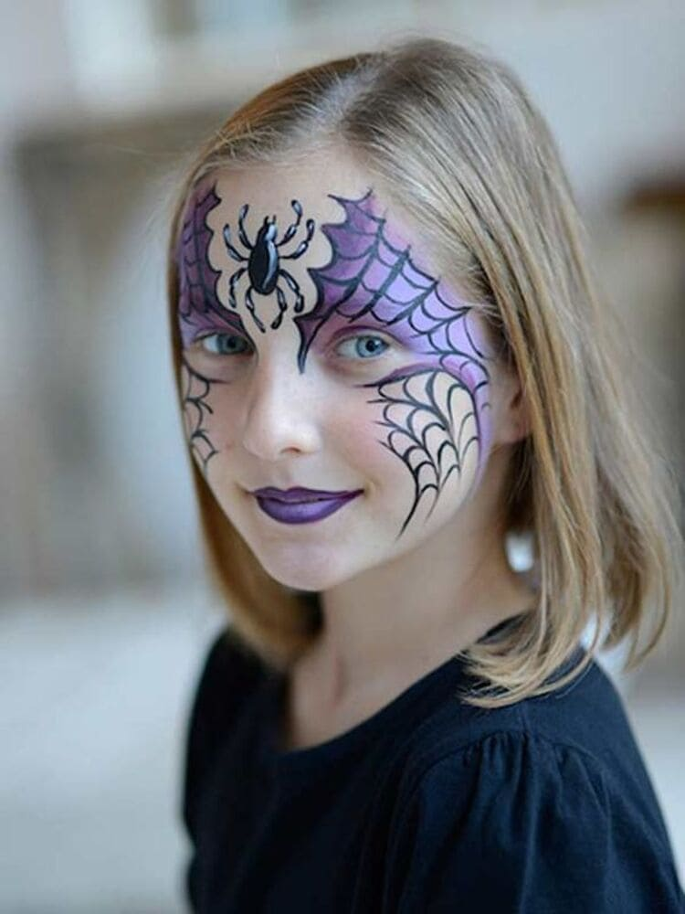 girl with black and purple spider web and spider on her face