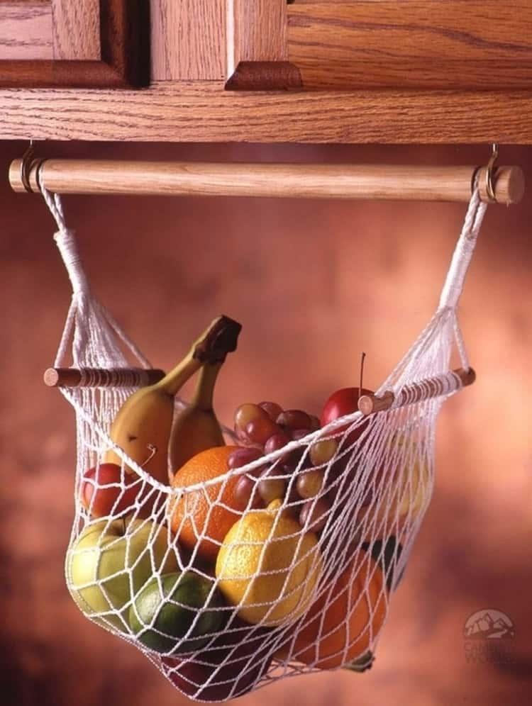 fruit hammock holding a variety of fruit
