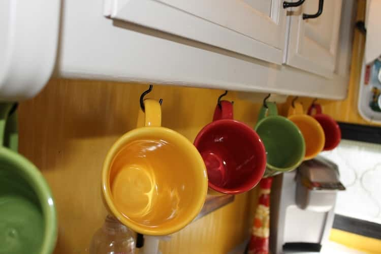 hang your coffee mugs in the RV to save cabinet space